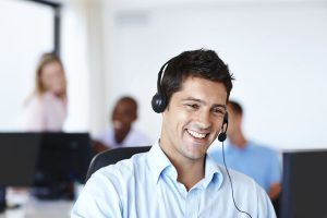 Young man wearing a headset having a conversation